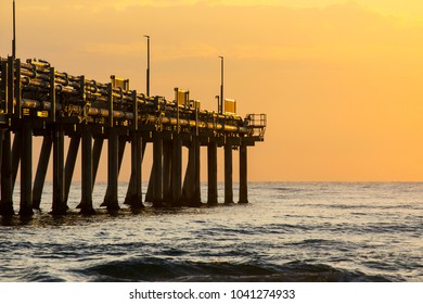 Close up of Gold Coast Sand Pumping Jetty with sunrise colours in the sky