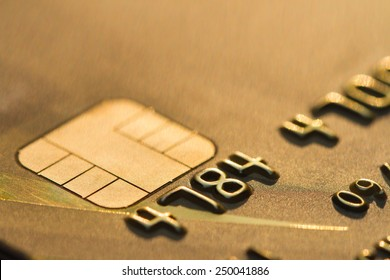 close up gold color credit card. concept EMV chip card is a  technical standard for smart payment cards  , One of the digital banking, It gives the customer a more comfortable.