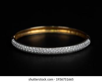 Close up Gold Diamond Bracelet Isolated on Black Background
