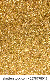 Close Up of Gold Glitter with Bokeh For Background