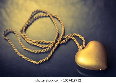 Close up of Gold heart pendant with necklace