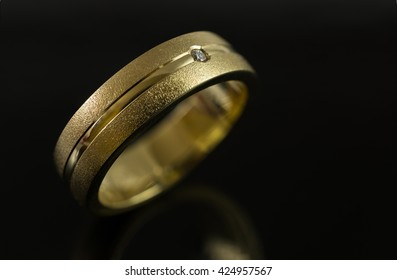 Close up of gold ring on black background
