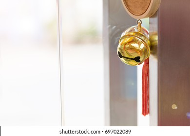 Close up golden bells with bless good lucky on the door background.