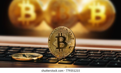 Close up golden bitcoin coin crypto Currency background concept. Golden bitcoin coin on the black laptop keyboard. Macro.