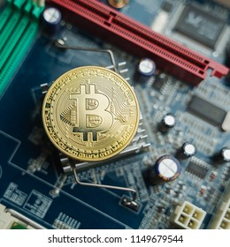 Close up of golden Bitcoin coins on electronic circuit board use for Cryptocurrency Business , finance , trading or investment concept background