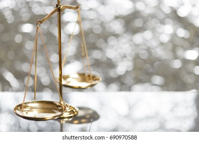 Close up of golden brass balance scale, Sign of justice on bokeh background