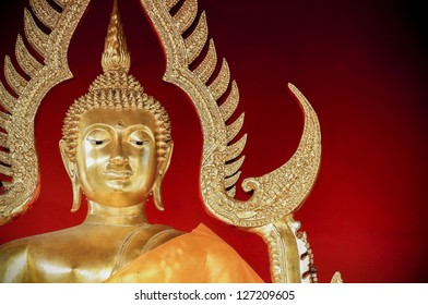 Close up of Golden Buddha Statue of Temple,Thailand isolated on red background