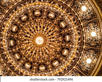 Close up of golden chandelier lamp at Colon Theatre (Teatro Colon) in Buenos Aires, Argentina, vintage luxury background.