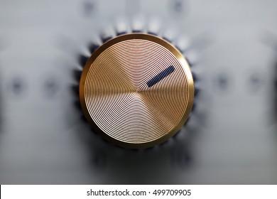 close up of golden knob guitar amplifier