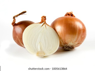Close up of golden onion and cut in half
