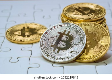 Close Up Golden and silver Bitcoin, Selective Focused on jigsaw ground. Electronic Money And Finance Concept.