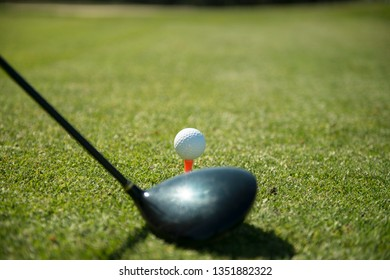 close up of a golf ball before it will be hitting by the drive