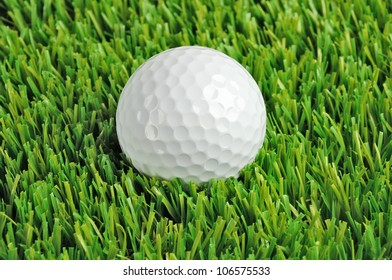 close up of a golf ball in the grass
