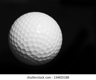 close up golf ball isolated on black color, sport competition background, sport club concept