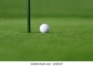 so close  golf ball near hole
