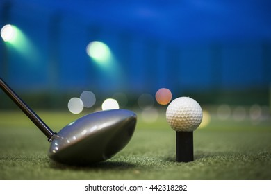 Close up of golf ball on green field