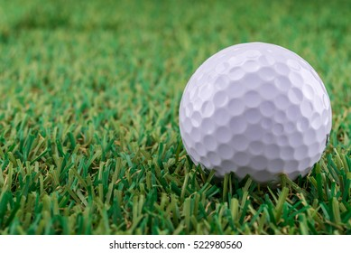 Close up Golf ball on the green.