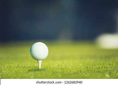 Close up of golf ball on tee. Concept of the fresh start. Horizontal