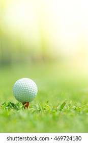 Close up of Golf ball on Tee, Golf ball Ready to be shot, Golf sport is Balance of Yin Yang.Paste the text into the space  right hand side. Sport background.