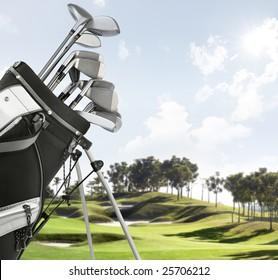 close up of golf equipment, course as background