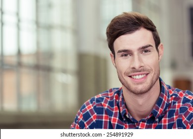 Close up Good Looking Man in Checkered Shirt, Smiling at the Camera. Emphasizing Copy Space.