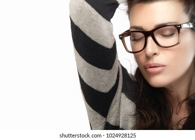 Close up gorgeous brunette fashion model girl with casual style clothing wearing trendy glasses, Holding her hair with closed eyes. Cool trendy eyewear portrait isolated on white background