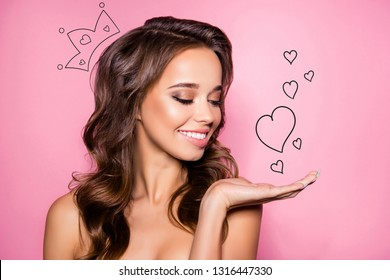 Close up of gorgeous charming brown wavy-haired lady ideal face presenting new product. Sales marketing discounts ad pampering lips dermatology healthcare concept isolated over pink pastel background