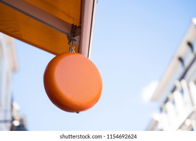 close up Gouda or Edammer cheese hanging on roof