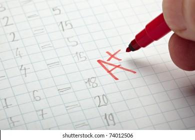 close up of grade a and math examination