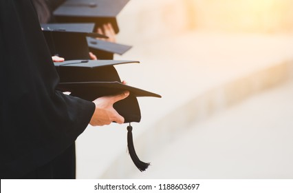 Close up Graduate holding a hat. Concept sucess education in University with copy space. Education graduation in university theme concept.