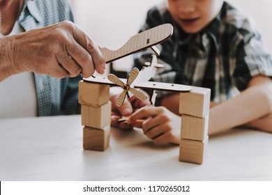 Close up Grandpa and Grandson Playing with Toys. Family Relationship Between Grandfather and Grandson. Grandpa Teaching, Male Grandchild, Learning Concept. Relations and People Concept.