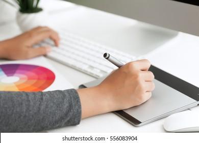 close up graphic design using digital pen tablet on desk workspace
