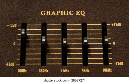 Close up of a graphic equalizer on a electric guitar amp.