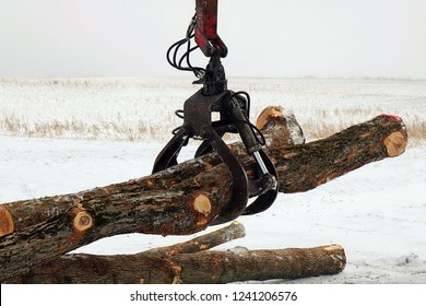 Close up of grappling hook moving logs