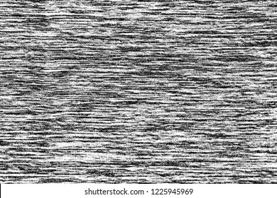 Close up gray cotton fabric texture background.   Black and white textured knit fashion fabric background.  Selective focus. top view.