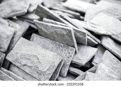 Close up gray stone tiles on stack.