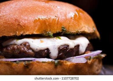 Close up Great Burger beefon a wooden table