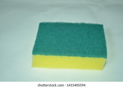 Close up gree scouring pad and sponge isolated on white background with copy space. text message. scouring pad and sponge is a cleaning tool used for scouring a surface and cleaning a dishes after coo