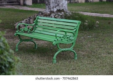 Close up of Green bench in park
