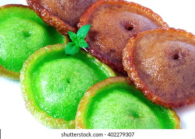 Close up of green and brown kuih Pinjaram on a plate, Kuih Pinjaram is a traditional kuih for Bajau, Bruneian Malay people in Brunei and in the states of Sabah in East Malaysia. Made from rice flour.