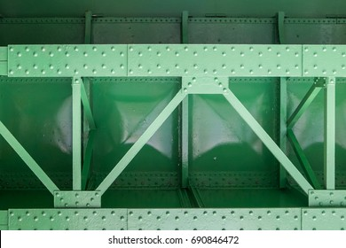 close up of green metal bridge structure for support trains