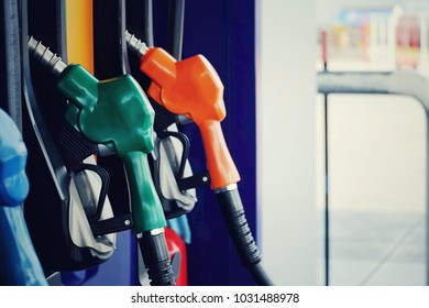 close up green nozzle fuel at pump gas station, saving energy and money for transport, transporation technology
