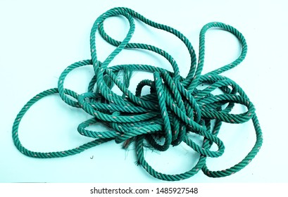 close up Green nylon rope curled on a white background
