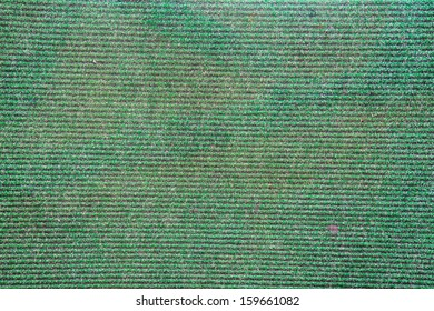 Close up green old doormat