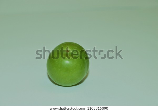 Close up of green plum. Fresh green plum fruit isolated on white. Green and delicious sour plum. Popular spring fruit in middeleast.