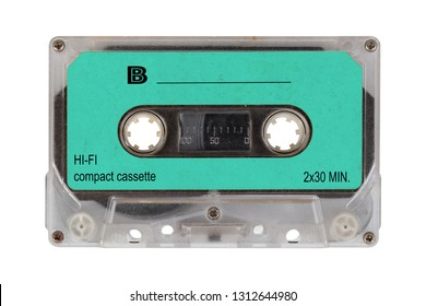 Close up green retro cassette tape from the 80s, isolated on white background. Retro  cassette tape.