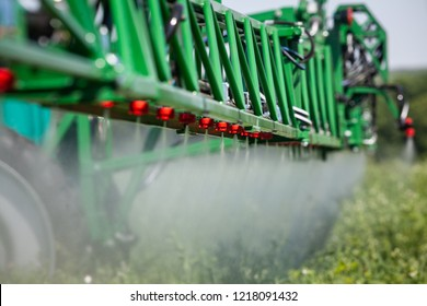 close up green sprayer to protect plants while working in the field