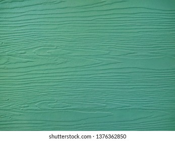 Close up green wood substitute board and high quality of fiber board  texture and background for design and architect, Beautiful wooden plank patterns from cement striped wood wall