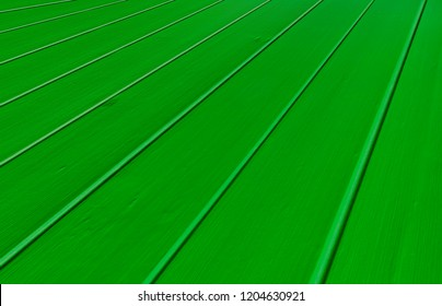 A close up of green wooden floorboards for use as  a background or design element