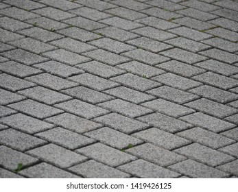 Close up of grey brick block paving on a drive in rural Germany